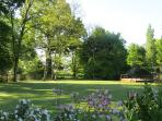 A large garden with sunny lawns and shady spots for all to enjoy