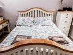 Very comfortable king size solid oak sprung bed
