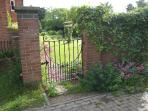 Looking through the side gate into the garden