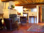 Large lounge, dining room, and country style kitchenette