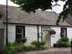 The beautiful listed Abbey Green Cottage, loctaed in the heart of the village cobbled square.