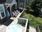 The back deck with hot tub gets all the afternoon sun, perfect for relaxing with a glass of wine.