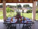 Under the covered patio it is pssible to have  yor meals or spent your relaxing moments