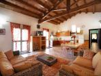 the main room of the villa,  a well equipped kitchen, a table 12/14 people and a comfortable lounge
