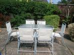 Sunny rear garden with table and chairs for 6 people and BBQ