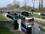 A narrow boat 'locking through'