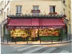 The nearest grocery is the famous one of the film 'The Fabulous Destiny of Amélie Poulain'