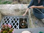 enjoy the cool air of the well where you can refresh wine bottles