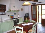 Living room-kitchen with sofa, kitchen facilities include an oven, dishwasher, with a large fridge a