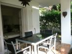 Outside dining area leading into terrace garden