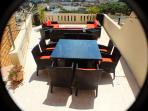 Terrace with Lounge Suite and Dining Table/Chairs near the 3 bedroom apartment on 1 st floor