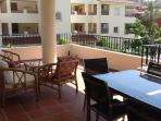 Spacious balcony with Our dining table  seats 6 easily  and settee and 2 chairs