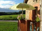 A summers evening on the cottage terrace at Le Boucharel, Champagnac le Vieux, Livradois Forez