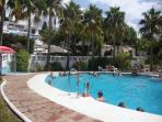 main family pool adjacent to pool bar, resturant, patios, gardens & childrens pool, lifeguard on dut