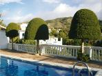 pool adjacent to our patio & mountain views
