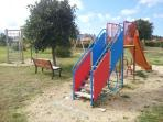 Take a break with the children at the play ground.