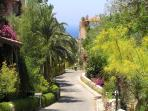 Winding paths lead through the tropical gardens towards the sea