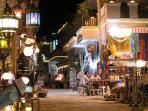 Eclectic shops spill out in the alleys at night