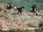 Divers on coastline near La Zenia