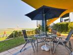 Patio with views to golf course, garden & pool