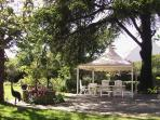 Big garden with dining set, to enjoy a meal in a sunny day
