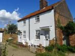 Loom Cottage (far side) in  Spinners Lane.  These are the 1st cottages on the right as you enter.