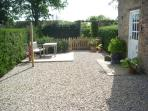 The private sunny courtyard welcomes you to Close House Cottage