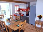 Large dining Room & Kitchen with very large outside decking and Barby area.
