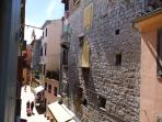 Bedroom 2 overlooks medieval street with lovely stone houses and palaces