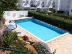 The attractive shared Pool and sunbathing area