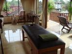 Upstairs living room and massage table