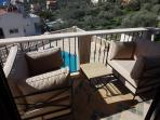 Relax on the comfy balcony seating area