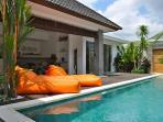 sun bed in pool