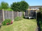 Lawn area of rear garden with trampoline