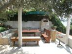The open air dining area under the olive trees