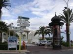 Downtown Menton with signpost to adventure
