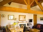 Cottage has bags of character; living area is open to the rafters and has the most wonderful beams