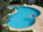 view of pool from sitting room balcony
