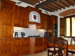 Craftsman built kitchen conveniently close to dining area