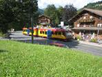 Local tram stopping at the tourist office in Barboleuse