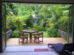 Decking (recently added) with private garden.  Sea is in the background.