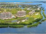 Secluded Waterfront Condo, 2 tennis courts, golf, 2 pools and bay views. Private beach club
