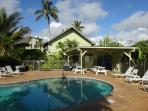 Tropical pool with barbeque and dining area