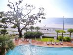 Condo balcony overlooks pool and has great views of Gulf of Mexico
