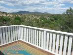 deck off large upstairs bedroom with mountain views