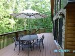Generous 12x40 ft. deck with comfortable log furniture is a great place for gatherings or quiet book