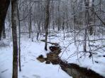 Fox creek in the winter time located on the property