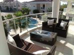 The spacious balcony looking down to the  pool in the background