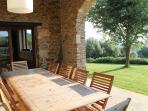 Outdoor dining in arched eating area. Adjacent to kitchen and overlooking gardens and pool