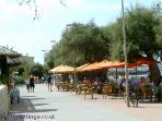 Colonia de Sant Pere with its many Bars & Restaurants Overlooking The Bay.